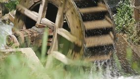Old Traditional Mechanism Wooden Wheel Producing Energy Using Water Force.  stock footage