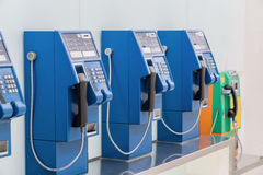 Old and traditional public telephones using the coins Stock Photography
