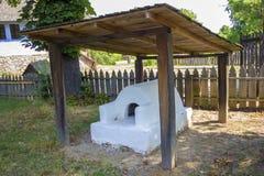 Old traditional romanian earthen stove Stock Photos
