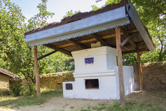Old traditional romanian earthen stove Stock Photography