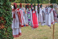 Old traditional Romanian folk costumes with embroidery. Specific for Bistrita-Nasaud area Romania and exposed for sale at one traditional fair stock image
