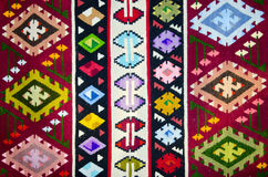 Old traditional romanian wool carpet. With ancient motifs Stock Photo