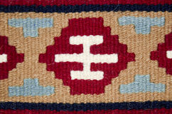 Old traditional romanian wool carpet. With ancient motifs Royalty Free Stock Images