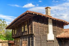 Authentic old house in the village of Zheravna, Bulgaria. Old traditional rustic house made of wood with tile roof against blue sky, Zheravna, Bulgaria royalty free stock photos