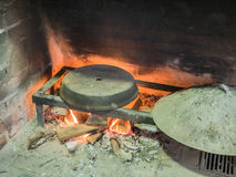 Old traditional stone bread oven stove with burning wood fire and red flames inside Royalty Free Stock Photos