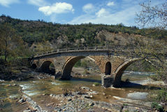 Old traditional stone made bridge at Epirus. Greece Royalty Free Stock Photography