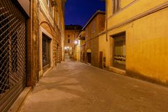 Siena. Old city street at night. An old traditional street with a cobblestone street at night. Siena. Tuscany. Italy Stock Images