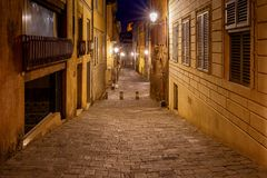 Siena. Old city street at night. An old traditional street with a cobblestone street at night. Siena. Tuscany. Italy Royalty Free Stock Images