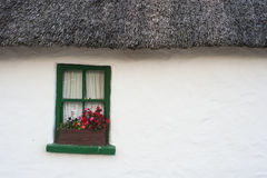 Old traditional Thatched Irish cottage background Royalty Free Stock Photography