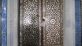 Old traditional turkish colored mosaic. Colored turkish mosaic wall with many details close up recording stock video