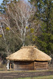 Old traditional Ukrainen barn or shack under blue sky Stock Images