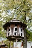 Old traditional ukrainian wooden beehive with tree background stock photo