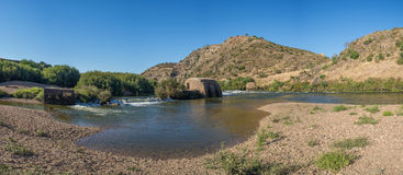 Old traditional water mill in Guadiana river in Mértola, Algarve Royalty Free Stock Photos