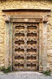 Old Traditional Weathered and Carved Door. With Brown Color Royalty Free Stock Photography
