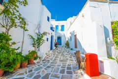 Old traditional white houses on the street. In Lefkes village, Paros, Greece stock photo