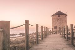 Old traditional wind-mill. In sand-hills of Apulia Portugal royalty free stock photography