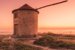 Old traditional wind-mill. In sand-hills of Apulia Portugal royalty free stock photo