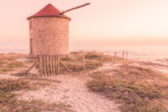 Old traditional wind-mill. In sand-hills of Apulia Portugal stock photos
