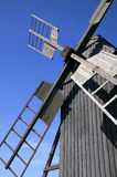 Old traditional windmill. With blue sky in the background Royalty Free Stock Photo