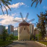 Old traditional windmill at public park in sunny summer day Stock Image