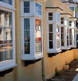 Old traditional windows of many houses in england Stock Photography