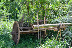 Old traditional wooden cart in the middle of bamboo forest. Picture taken during rainy season in Inle Lake, Myanmar Royalty Free Stock Photography