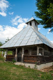 Old traditional wooden church in rural Romania Stock Photos