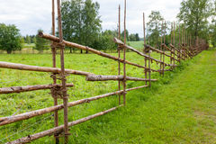 Old traditional wooden fence and meadow Stock Images