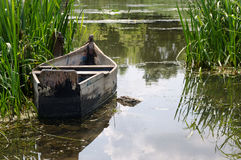 Old traditional wooden rowboat a beautiful lake Stock Image