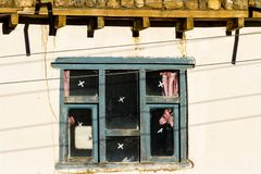 Old traditional wooden window a in small local village in Nepal, Himalaya.  royalty free stock photo