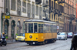Old traditional yellow tram on the street of Milan Royalty Free Stock Images