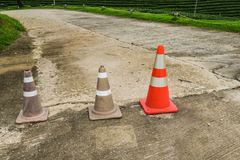 Traffic cone on concrete road. Old traffic cone on concrete road Royalty Free Stock Photo