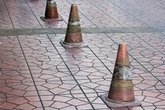 Old traffic cones placed on the sidewalk. Traffic cones were placed on the floor of the old pavement stock photos