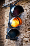 Old traffic light. In italy Royalty Free Stock Photos