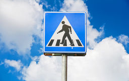 Old traffic sign pedestrian crossing with blue sky Royalty Free Stock Photography