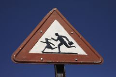 An old traffic sign warning for children crossing the road Stock Photo