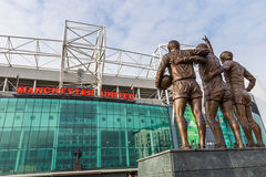 Old Trafford football stadium. Manchester, England - February 27, 2016: The east stand of Old Trafford football stadium, home of Manchester United. With a Royalty Free Stock Images
