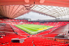 Old Trafford stadium. Manchester, UK - February 27, 2016: Old Trafford is a football stadium in Old Trafford, Greater Manchester, England, and the home of Stock Images