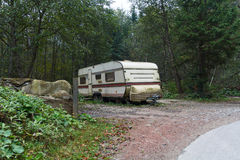Old trailer is in the woods Royalty Free Stock Photos