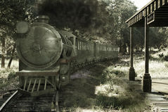 Old Train arriving at the Station. An old steam train arrives at a railroad station under several trees. Image on a grunge background Royalty Free Stock Photo