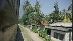 Old train arriving to the small sri lanka mountain village. stock footage