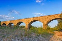 Old train bridge in Greece. Royalty Free Stock Photo