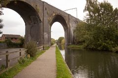 Old train bridge made of red bricks masonry stock images