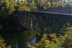 Old train bridge. Over the Bobr river in Bobr Valley in Poland in autumn secenery Stock Photo