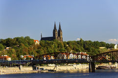 Old train bridge over the Vltava river in Prague on a nice summer day Royalty Free Stock Image