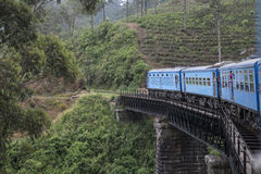 Old Train on the bridge in the tea plantations. Ella, Sri Lanka. Old train going on the old bridge in the green tea plantations. Ella, Sri Lanka stock photography