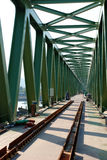 Old train Bridge under construction. Steel construction from under the bridge Royalty Free Stock Photos