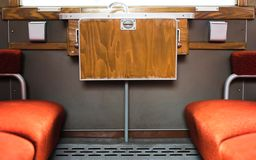The old train carriage from bygone times. The train carriage with red seats from bygone times stock photos