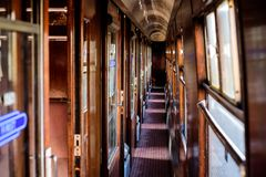 Old train carriage. Old first class train carriage with wooden cabins and original fixtures Royalty Free Stock Photo