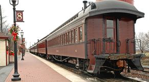 Old train cars at train station. Old passenger train or rail car at station Stock Images